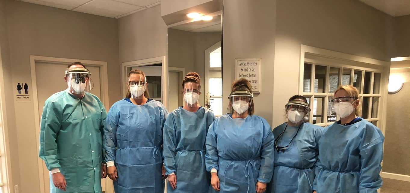 team in full PPE